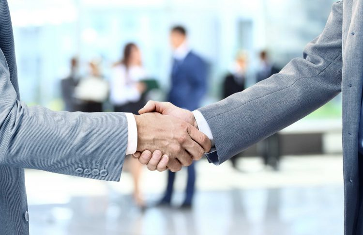 Men shaking hands after closing a deal - Mincoffs Solicitors